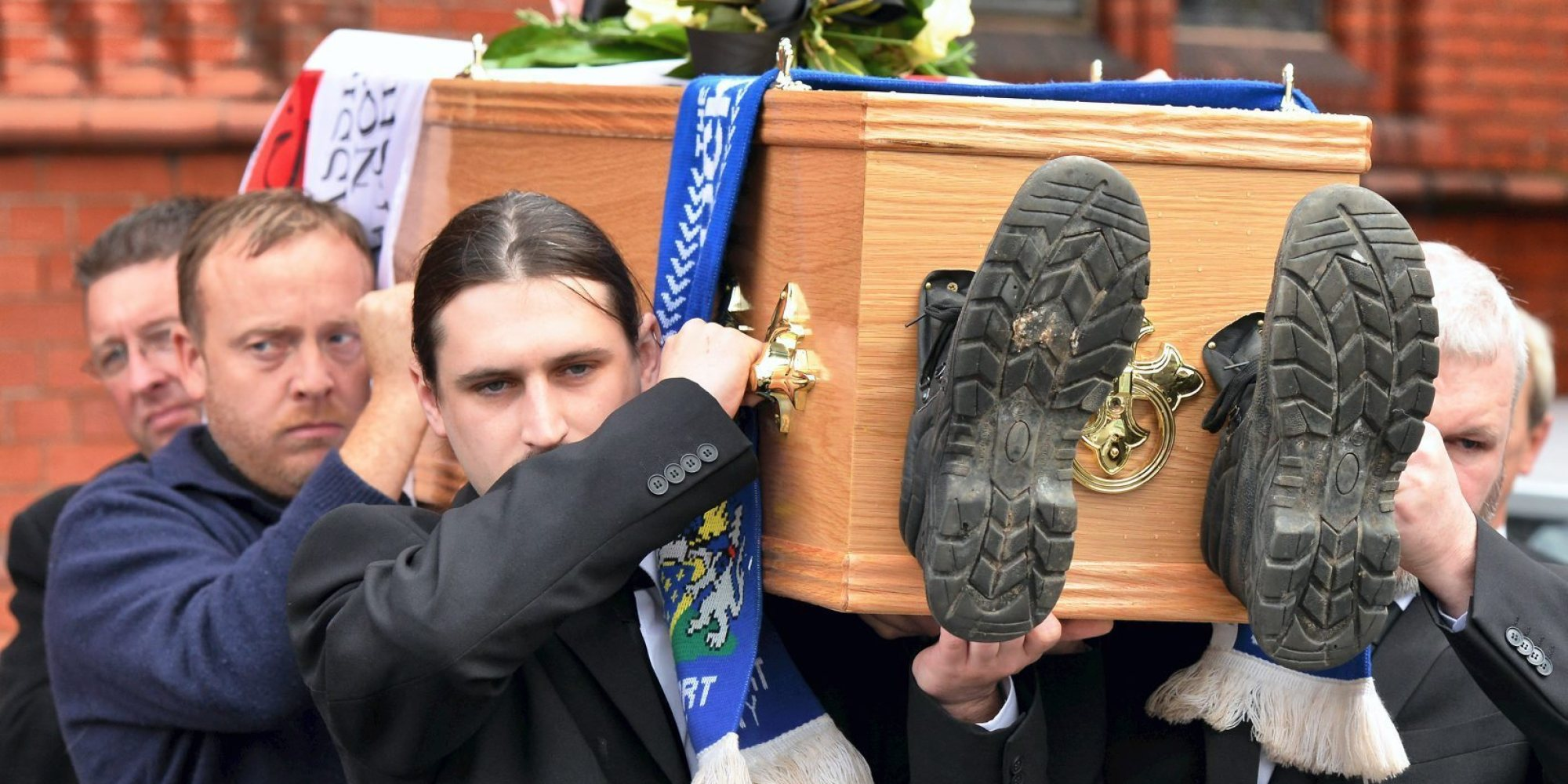 AN AVID Stockport County fan who died suddenly was given a fitting send off thanks to fellow supporters... Jason Calvert, 40, from Cheadle Heath, suffered a fatal brain haemorrhage earlier this month... .. CAPTION The funeral of Jason Calvert at Our Lady's Church in Shaw Heath Stockport - boots on coffin... Pic from MEN Syndication.. .. Mitchell Henry House.. Hollinwood Avenue.. Chadderton.. Oldham.. OL9 8EF.. syndication@men-news.co.uk