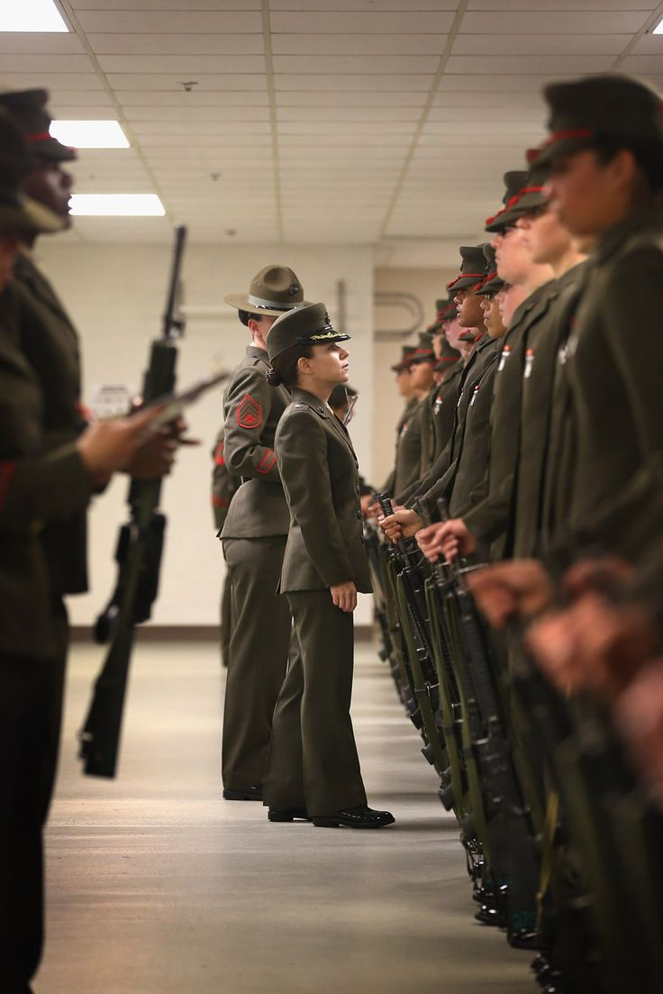 PARRIS ISLAND, SC - FEBRUARY 26:  LtCol. Gabrielle Hermes inspects Female Marine recruits under her command and nearing their graduation from boot camp on February 26, 2013 at MCRD Parris Island, South Carolina. Female enlisted Marines have gone through recruit training at the base since 1949. About 11 percent of female recruits who arrive at the boot camp fail to complete the training, which can be physically and mentally demanding. On January 24, 2013 Secretary of Defense Leon Panetta rescinded an order, which had been in place since 1994, that restricted women from being attached to ground combat units.  (Photo by Scott Olson/Getty Images)
