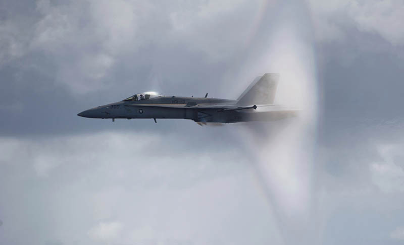 110531-N-DR144-605 PACIFIC OCEAN (May 31, 2011) An F/A-18C Hornet assigned to Strike Fighter Squadron (VFA) 113 breaks the sound barrier over the Nimitz-class aircraft carrier USS Carl Vinson (CVN 70) during an air power demonstration. Carl Vinson and Carrier Air Wing (CVW) 17 are underway in the U.S. 7th Fleet area of responsibility. (U.S. Navy photo by Mass Communication Specialist 2nd Class James R. Evans/Released)