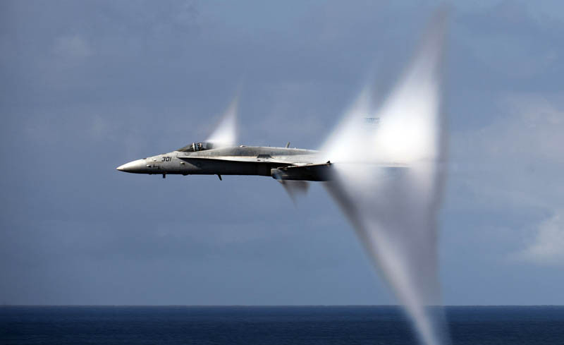 110606-N-TU221-408 PACIFIC OCEAN (June 6, 2011) An F/A-18C Hornet assigned to Strike Fighter Squadron (VFA) 113 breaks the sound barrier during an air power demonstration over the Nimitz-class aircraft carrier USS Carl Vinson (CVN 70). Carl Vinson and Carrier Air Wing (CVW) 17 are currently underway in the U.S. 7th Fleet area of responsibility. (U.S. Navy photo by Mass Communication Specialist 3rd Class Travis K. Mendoza/Released)